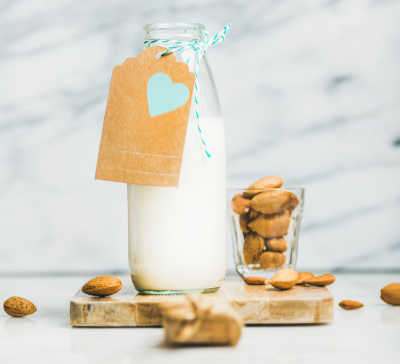 Fresh homemade dairy-free almond milk with craft paper label