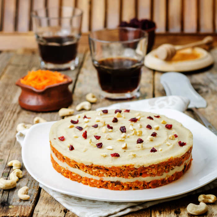 raw vegan carrot cake with cashew cream and dried cranberries