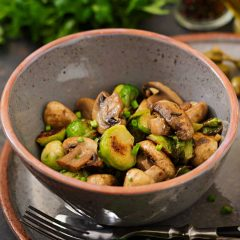 Vegan dish. Baked mushrooms with Brussels sprouts and herbs. Proper nutrition. Healthy lifestyle